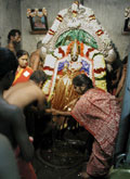 Performing Abhishegam to Swayambu